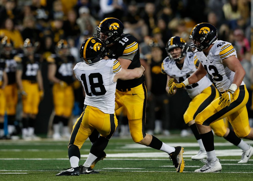 Iowa Hawkeyes tight end Drew Cook (18) and defensive back John Milani (18) during their final spring practice Friday, April 20, 2018 at Kinnick Stadium. (Brian Ray/hawkeyesports.com)