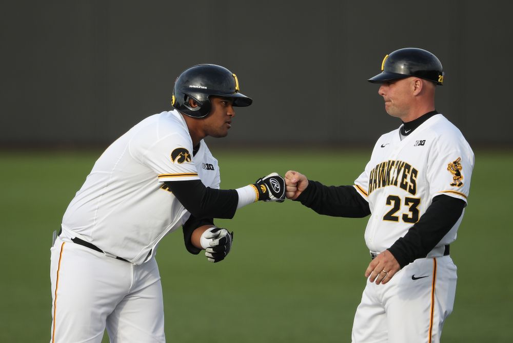 Iowa Hawkeyes Izaya Fullard (20) and assistant coach Robin Lund during game one against UC Irvine Friday, May 3, 2019 at Duane Banks Field. (Brian Ray/hawkeyesports.com)