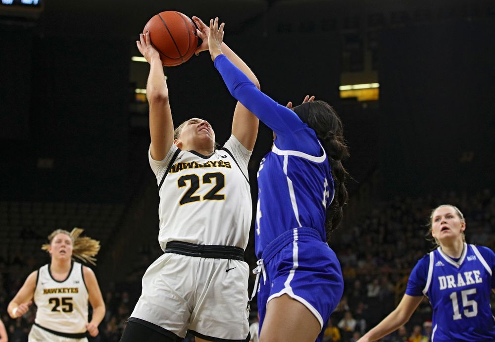 Iowa Hawkeyes guard Kathleen Doyle (22) makes a basket during the first quarter of their game at Carver-Hawkeye Arena in Iowa City on Saturday, December 21, 2019. (Stephen Mally/hawkeyesports.com)
