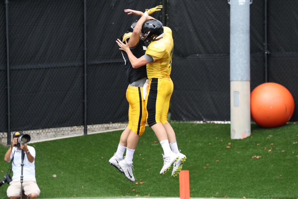 TE Nate Wieting and QB Spencer Petras celebrate in the End Zone