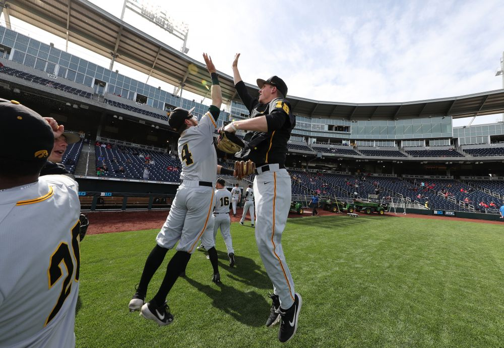 Iowa Hawkeyes infielder Mitchell Boe (4) and Shane Ritter (18) against the Indiana Hoosiers in the first round of the Big Ten Baseball Tournament Wednesday, May 22, 2019 at TD Ameritrade Park in Omaha, Neb. (Brian Ray/hawkeyesports.com)