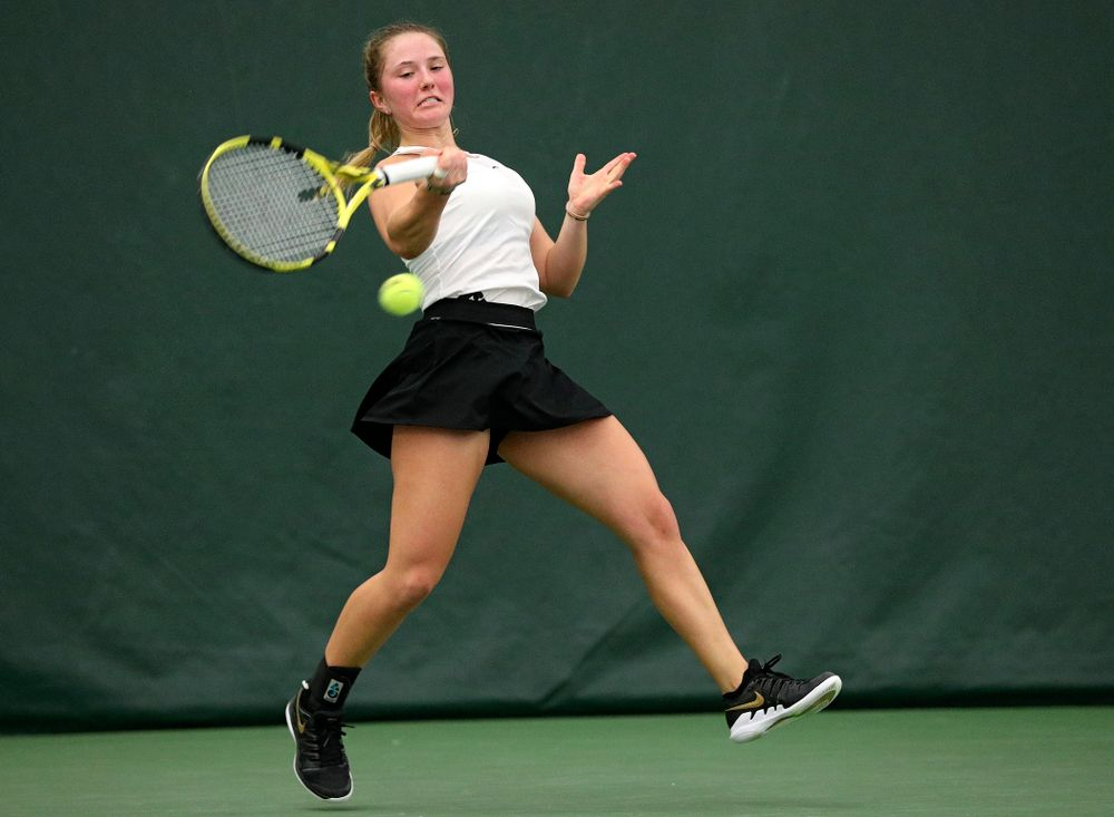 Iowa's Danielle Burich returns a shot during her singles match at the Hawkeye Tennis and Recreation Complex in Iowa City on Sunday, February 16, 2020. (Stephen Mally/hawkeyesports.com)