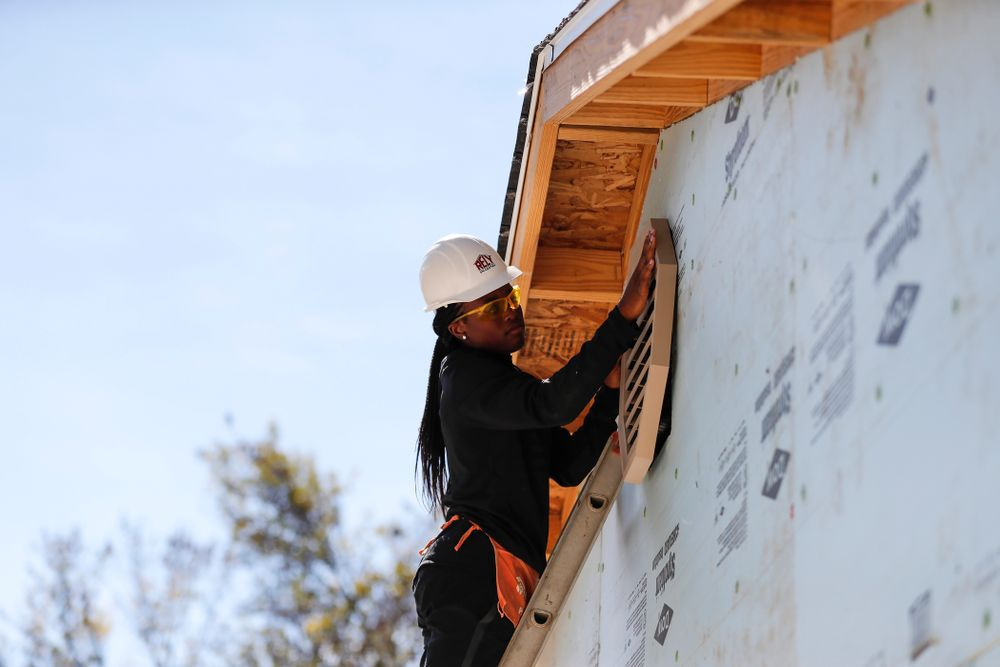 Iowa Hawkeyes guard Tomi Taiwo (1) works on the Habitat for Humanity Women's Build Wednesday, September 26, 2018 in Iowa City. (Brian Ray/hawkeyesports.com)