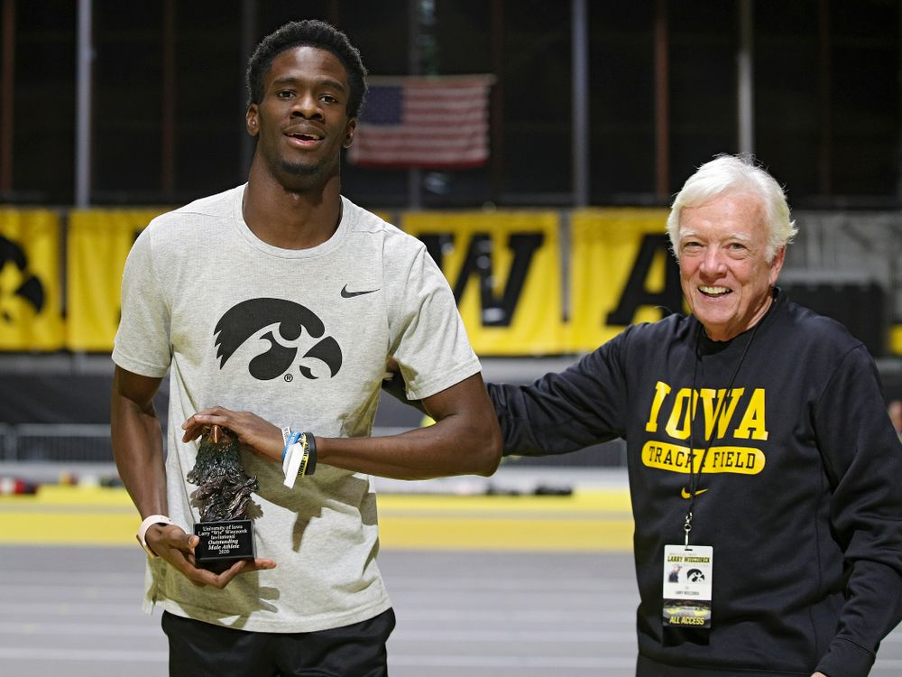 Iowa's Wayne Lawrence Jr. (from left) receives an award from Larry Wieczorek during the Larry Wieczorek Invitational at the Recreation Building in Iowa City on Saturday, January 18, 2020. (Stephen Mally/hawkeyesports.com)