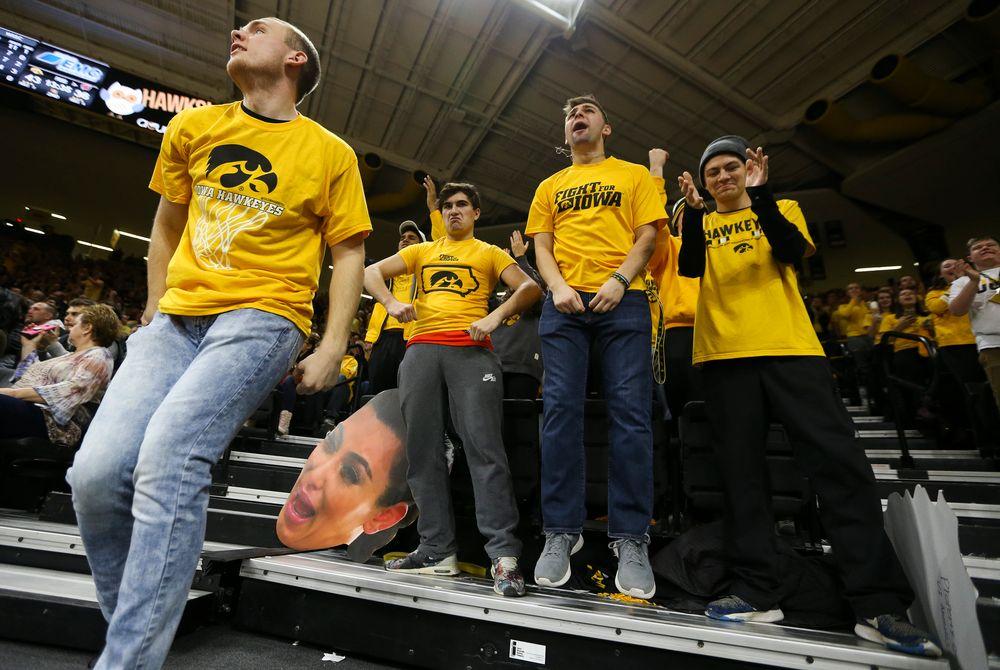Iowa Hawkeyes students cheer during a game against Wisconsin on November 30, 2018, at Carver-Hawkeye Arena. (Tork Mason/hawkeyesports.com)