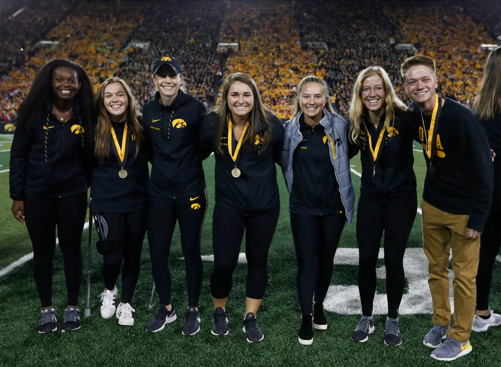 Members of the Iowa men's and women's tennis teams are recognized by the Presidential Committee on Athletics at halftime during a game against Wisconsin on September 22, 2018. (Tork Mason/hawkeyesports.com)