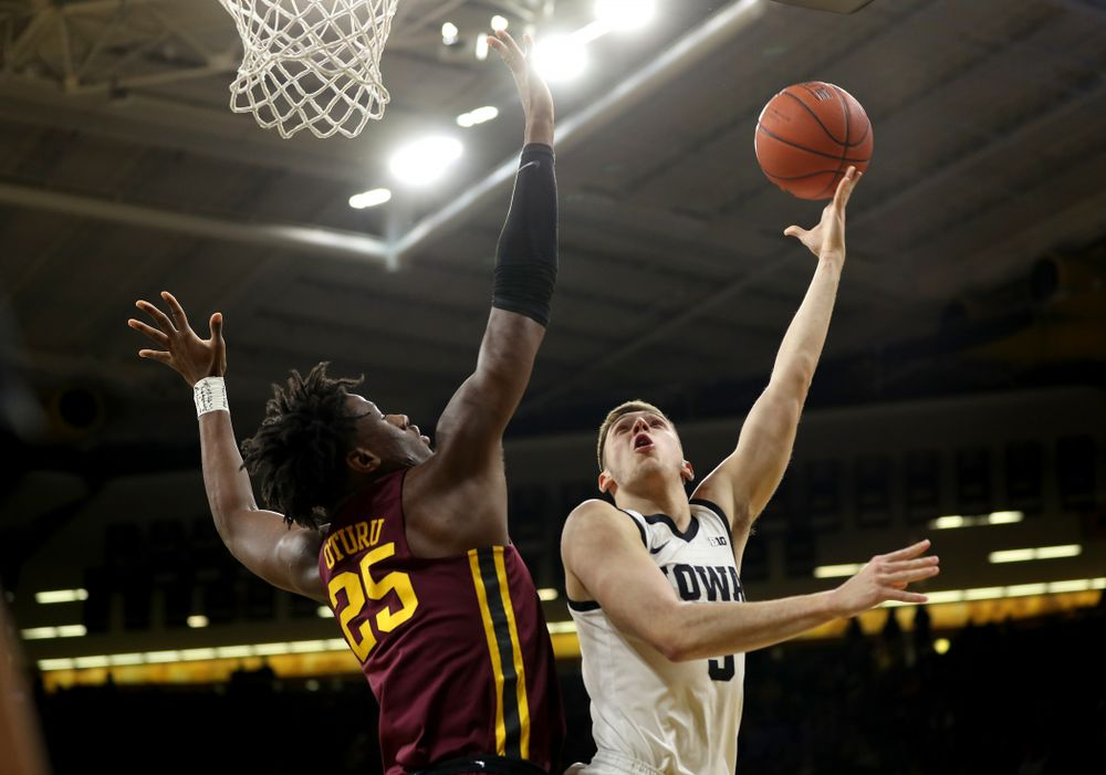 Iowa Hawkeyes guard CJ Fredrick (5) goes to the hoop against the Minnesota Golden Gophers Monday, December 9, 2019 at Carver-Hawkeye Arena. (Brian Ray/hawkeyesports.com)