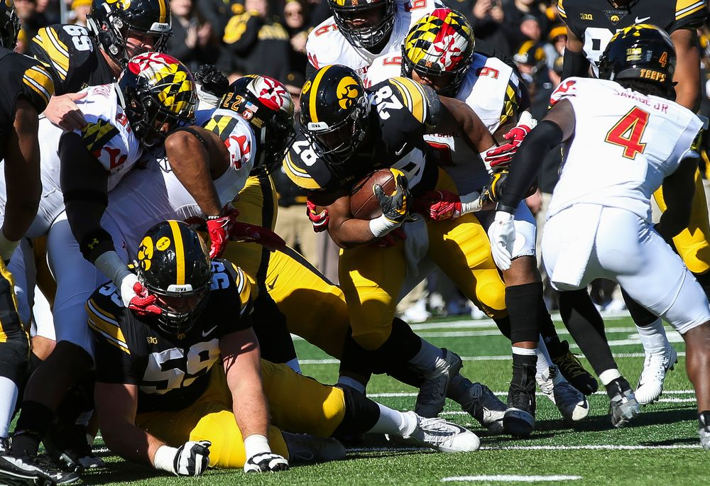 Iowa Hawkeyes running back Toren Young (28) runs the ball during a game against Maryland at Kinnick Stadium on October 20, 2018. (Tork Mason/hawkeyesports.com)
