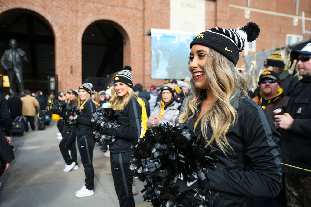 Iowa Spirit Squad members cheer during Iowa football vs Minnesota on Saturday, November 16, 2019 at Kinnick Stadium. (Lily Smith/hawkeyesports.com)