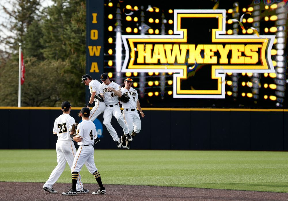 Iowa Hawkeyes outfielder Ben Norman (9), outfielder Robert Neustrom (44), and outfielder Justin Jenkins (6) against the Oklahoma State Cowboys Saturday, May 5, 2018 at Duane Banks Field. (Brian Ray/hawkeyesports.com)