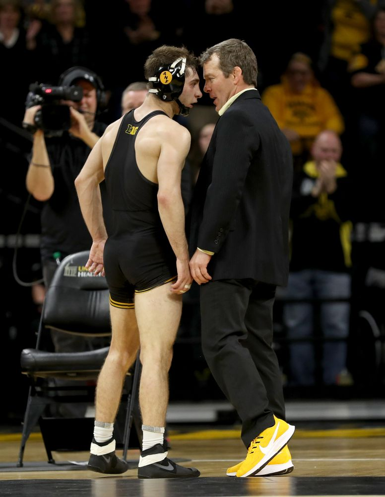Iowa head coach Tom Brands celebrates with Austin DeSanto after his match against Ohio State's Jordan Decatur at 133 pounds Friday, January 24, 2020 at Carver-Hawkeye Arena. DeSanto won the match with a 21-3 tech fall. (Brian Ray/hawkeyesports.com)