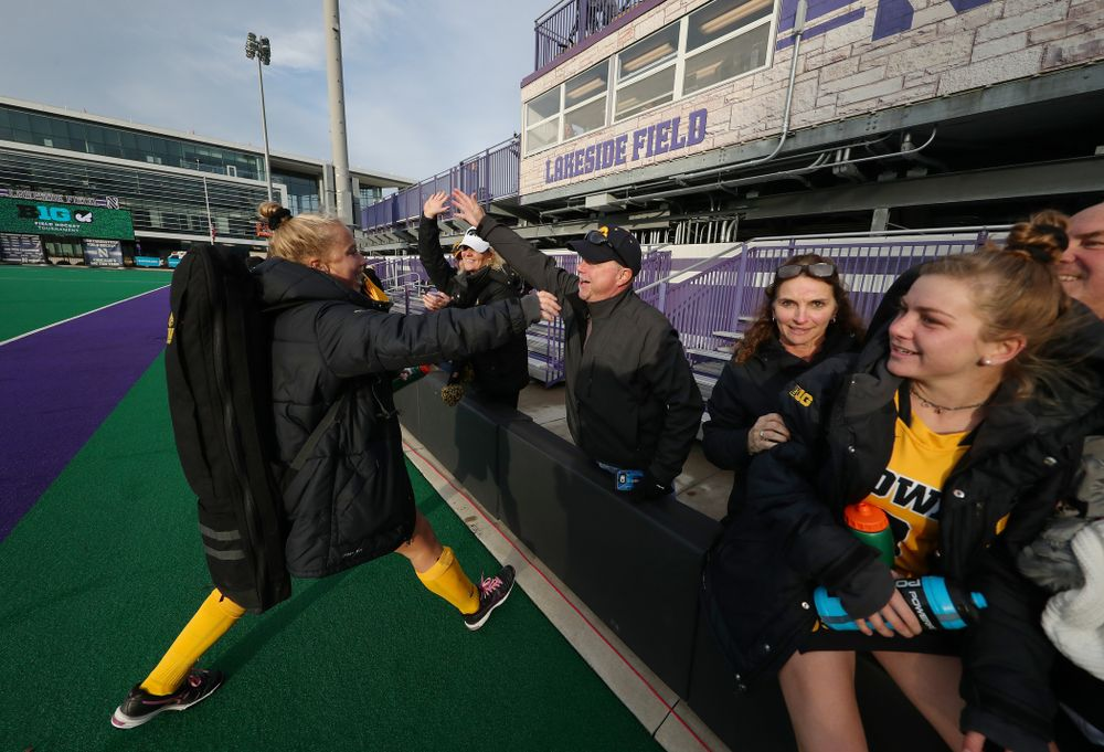 Iowa Hawkeyes Makenna Grewe (4) hugs her family after their 2-1 victory over the Michigan Wolverines in the semi-finals of the Big Ten Tournament Friday, November 2, 2018 at Lakeside Field on the campus of Northwestern University in Evanston, Ill. (Brian Ray/hawkeyesports.com)