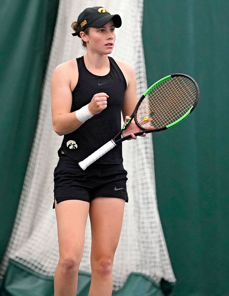 Iowa's Elise van Heuvelen Treadwell pumps her fist as she celebrates during their doubles match against Indiana at the Hawkeye Tennis and Recreation Complex in Iowa City on Sunday, Mar. 31, 2019. (Stephen Mally/hawkeyesports.com)