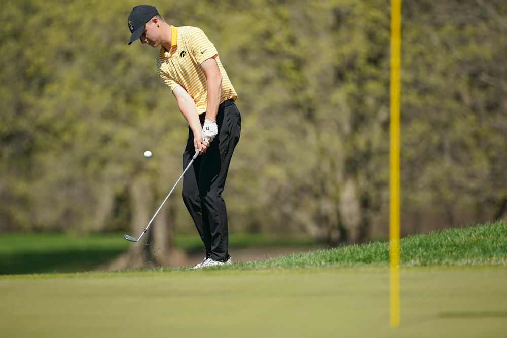 Iowa's Benton Weinberg chips onto the green during the third round of the Hawkeye Invitational at Finkbine Golf Course in Iowa City on Sunday, Apr. 21, 2019. (Stephen Mally/hawkeyesports.com)