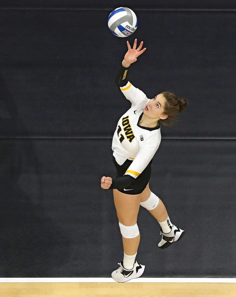 Iowa's Blythe Rients (11) tips the ball over the net during the second set of their match at Carver-Hawkeye Arena in Iowa City on Saturday, Nov 30, 2019. (Stephen Mally/hawkeyesports.com)