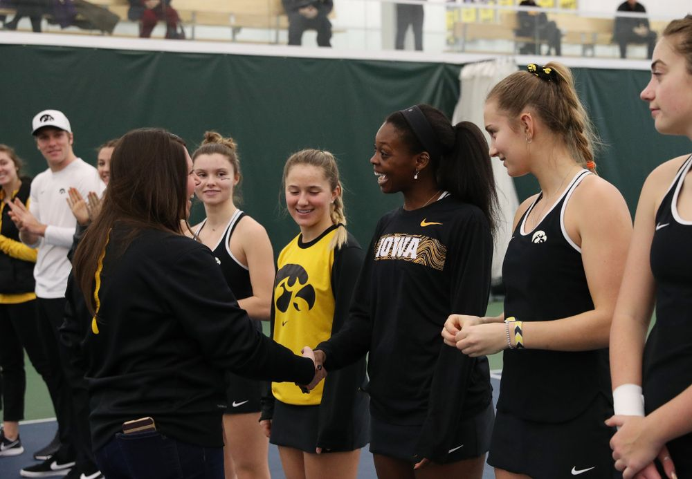 Academic Student Services Associate Director Kara Park congratulates Adorabol Huckleby for earning a 3.0 GPA or better during the fall semester before their match against the Penn State Nittany Lions Sunday, February 24, 2019 at the Hawkeye Tennis and Recreation Complex. (Brian Ray/hawkeyesports.com)