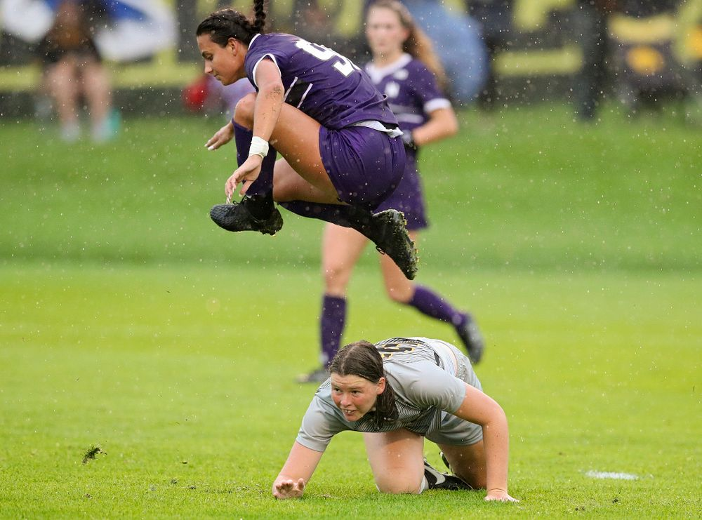 Iowa forward Samantha Tawharu (27) is tripped up as Northwestern's Julietta Thron (99) flies over top during the second half of their match at the Iowa Soccer Complex in Iowa City on Sunday, Sep 29, 2019. (Stephen Mally/hawkeyesports.com)