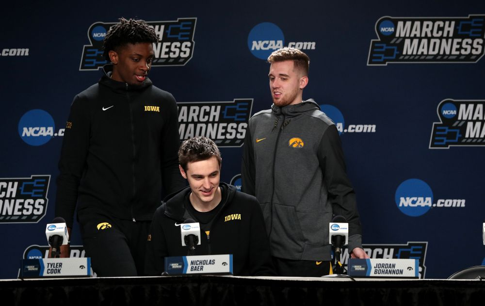 Iowa Hawkeyes forward Tyler Cook (25), forward Nicholas Baer (51), and guard Jordan Bohannon (3) during press availability and practice before the first round of the 2019 NCAA Men's Basketball Tournament Thursday, March 21, 2019 at Nationwide Arena in Columbus, Ohio. (Brian Ray/hawkeyesports.com)