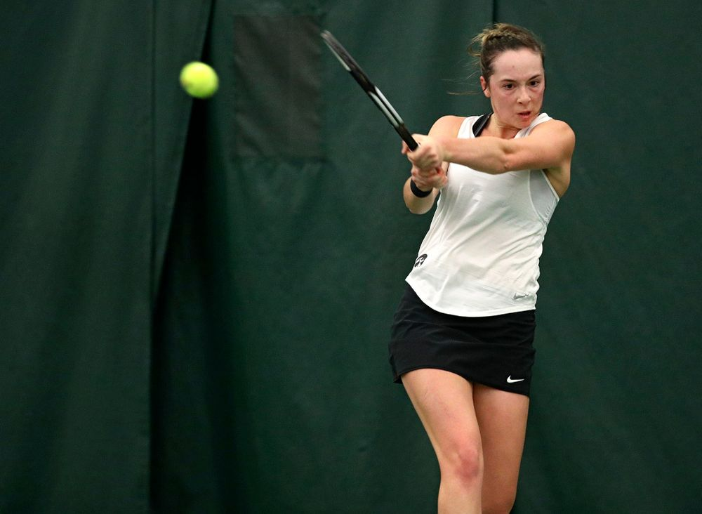 Iowa's Samantha Mannix returns a shot during her singles match at the Hawkeye Tennis and Recreation Complex in Iowa City on Sunday, February 23, 2020. (Stephen Mally/hawkeyesports.com)