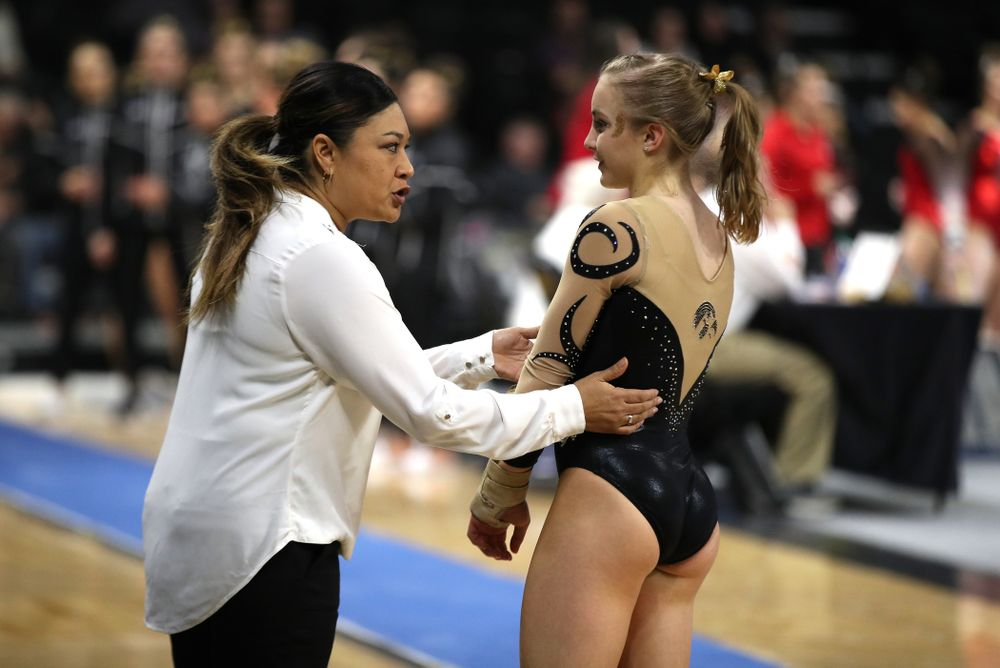 Iowa head coach Larissa Libby talks with Lauren Guerin during warmups for the vault during their meet against Southeast Missouri State Friday, January 11, 2019 at Carver-Hawkeye Arena. (Brian Ray/hawkeyesports.com)