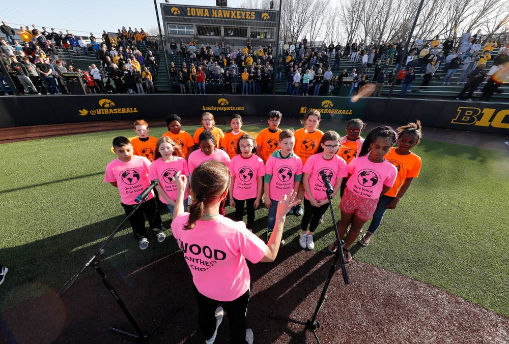 The National Anthem before the Hawkeyes game against the Michigan Wolverines Friday, April 27, 2018 at Duane Banks Field in Iowa City. (Brian Ray/hawkeyesports.com)