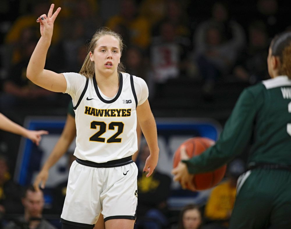 Iowa Hawkeyes guard Kathleen Doyle (22) holds up two fingers as she calls a play during the first quarter of their game at Carver-Hawkeye Arena in Iowa City on Sunday, January 26, 2020. (Stephen Mally/hawkeyesports.com)