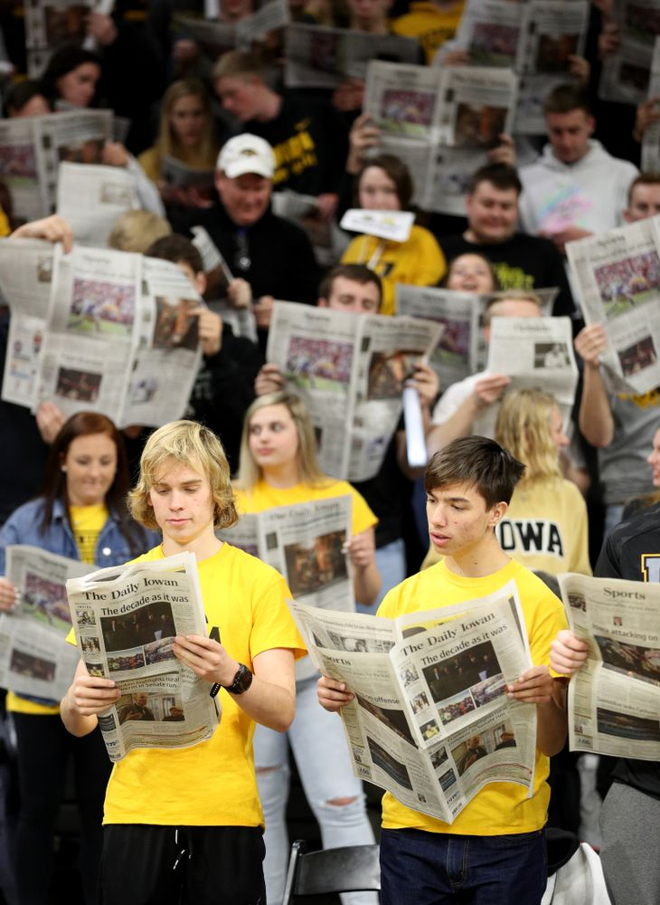The Hawksnest reads copies of the Daily Iowan during introductions before the Iowa Hawkeyes game against the Michigan Wolverines Friday, January 17, 2020 at Carver-Hawkeye Arena. (Brian Ray/hawkeyesports.com)