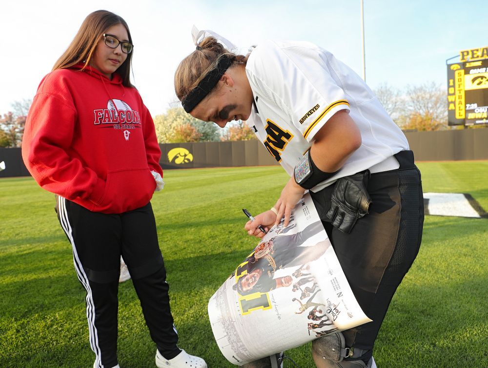 Iowa's Abby Lien (9) signs a poster for a fan after winning their game against Ohio State at Pearl Field in Iowa City on Friday, May. 3, 2019. (Stephen Mally/hawkeyesports.com)