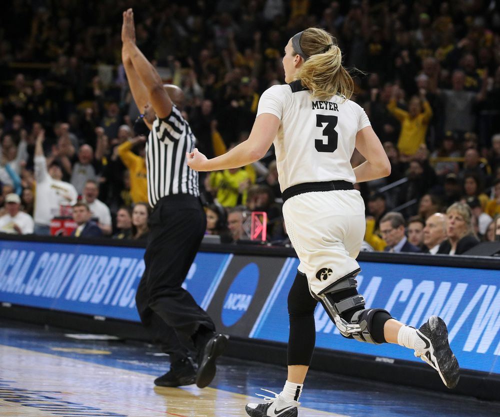 """Iowa Hawkeyes guard Makenzie Meyer (3) plays the """"air guitar"""" as she celebrates after making a 3-pointer during the fourth quarter of their second round game in the 2019 NCAA Women's Basketball Tournament at Carver Hawkeye Arena in Iowa City on Sunday, Mar. 24, 2019. (Stephen Mally for hawkeyesports.com)"""