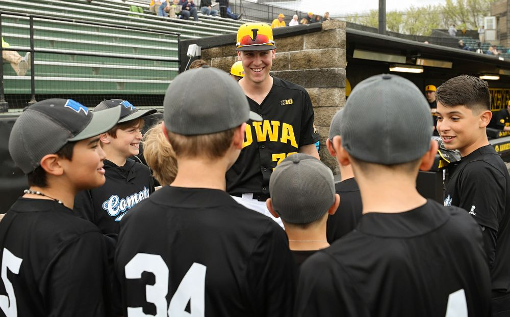 Iowa Hawkeyes right fielder Connor McCaffery (30) talks with some young fans before their game against Western Illinois at Duane Banks Field in Iowa City on Wednesday, May. 1, 2019. (Stephen Mally/hawkeyesports.com)