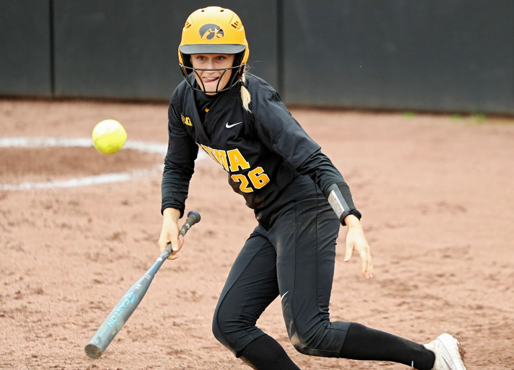 Iowa infielder Mia Ruther (26) lays down a bunt single which drives in a run during the fourth inning of their game against Iowa Softball vs Indian Hills Community College at Pearl Field in Iowa City on Sunday, Oct 6, 2019. (Stephen Mally/hawkeyesports.com)