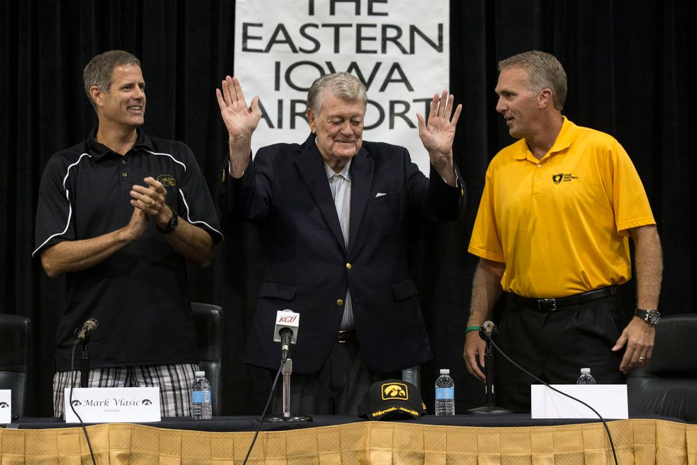 Former Hawkeye Football Head Coach Hayden Fry waves to the crowd at the start of a panel discussion with former quarterback Chuck Long during a panel discussion at Fry Fest Friday, Aug. 29, 2014 in Coralville.  (Brian Ray/hawkeyesports.com)
