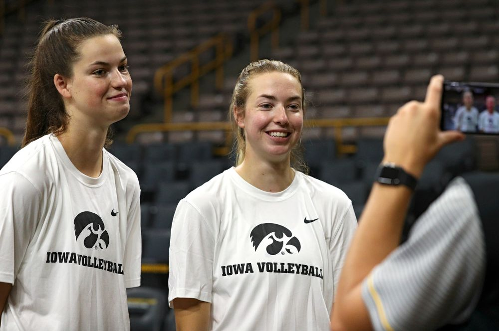 Iowa's Courtney Buzzerio (from left) and Meghan Buzzerio answer questions during Iowa Volleyball's Media Day at Carver-Hawkeye Arena in Iowa City on Friday, Aug 23, 2019. (Stephen Mally/hawkeyesports.com)
