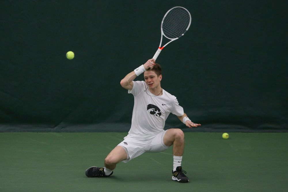 Iowa's Jason Kerst returns a hit during the Iowa men's tennis meet vs Nebraska on Sunday, March 1, 2020 at the Hawkeye Tennis and Recreation Complex. (Lily Smith/hawkeyesports.com)