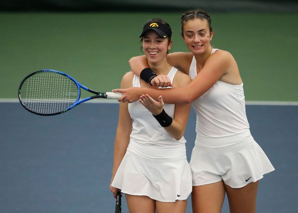 Samantha Mannix and Sophie Clark celebrate after winning a doubles match during the second day of the ITA Central Regional Championships at the Hawkeye Tennis and Recreation Complex on October 13, 2018. (Tork Mason/hawkeyesports.com)