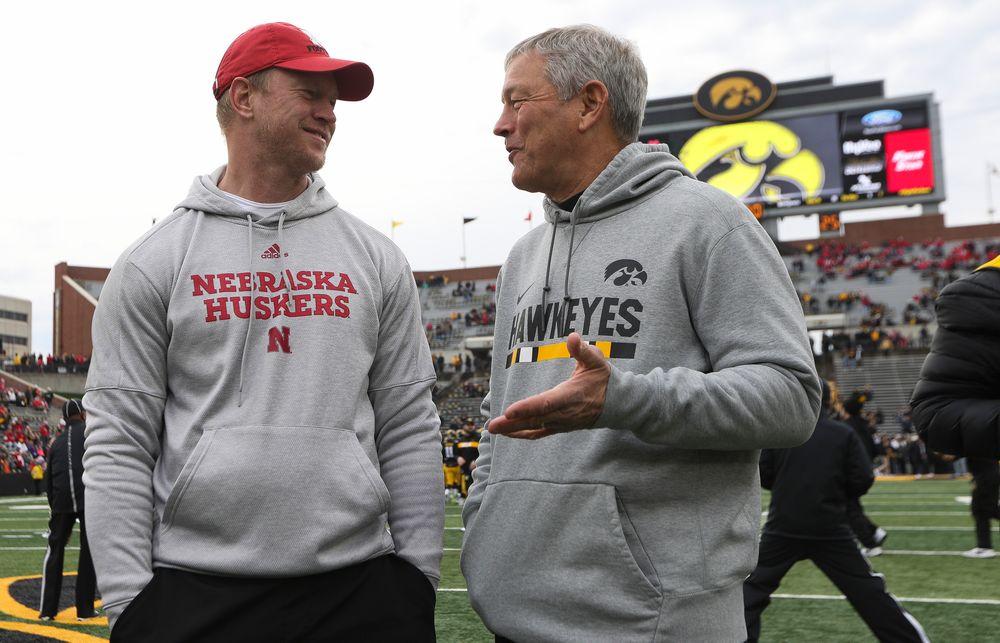 Iowa Hawkeyes head coach Kirk Ferentz talks with Nebraska Cornhuskers head coach Scott Frost before a game against Nebraska at Kinnick Stadium on November 23, 2018. (Tork Mason/hawkeyesports.com)