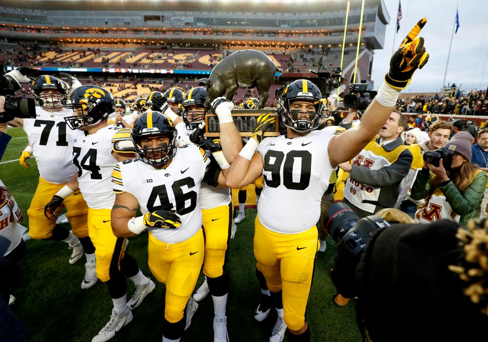 The Iowa Hawkeyes celebrate with the Floyd of Rosedale trophy following their win over the Minnesota Golden Gophers Saturday, October 6, 2018 at TCF Bank Stadium. (Brian Ray/hawkeyesports.com)