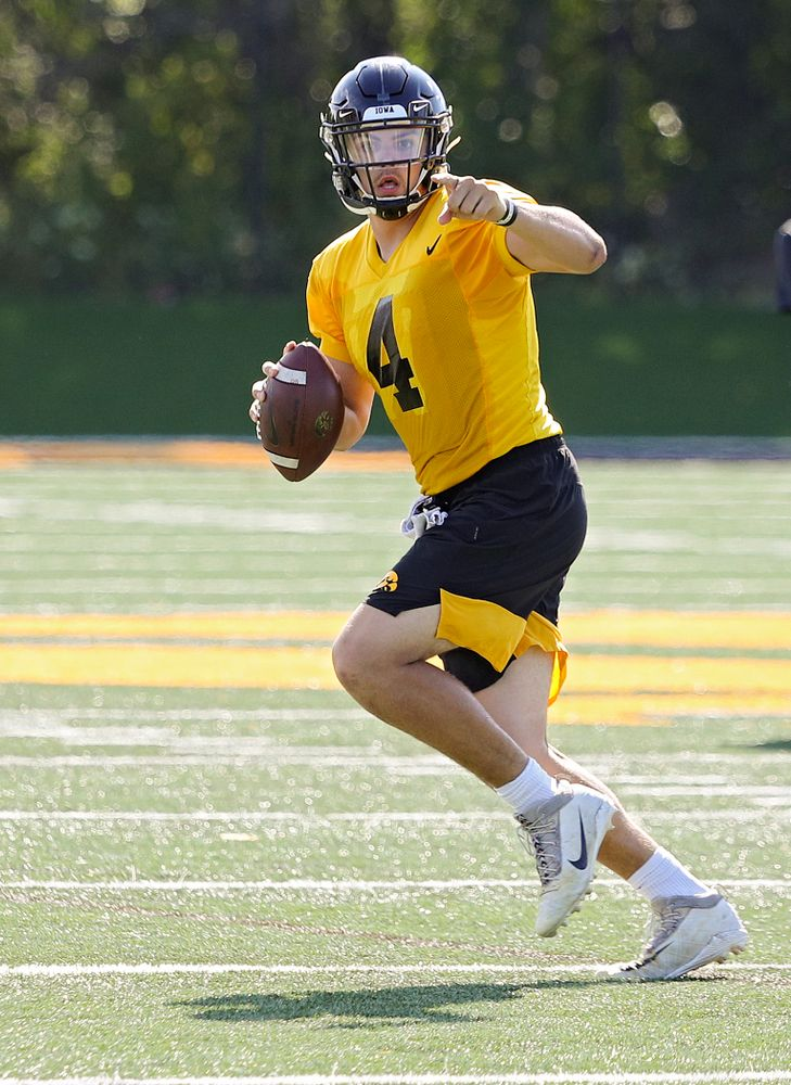 Iowa Hawkeyes quarterback Nate Stanley (4) directs traffic on the run during Fall Camp Practice No. 13 at the Hansen Football Performance Center in Iowa City on Friday, Aug 16, 2019. (Stephen Mally/hawkeyesports.com)