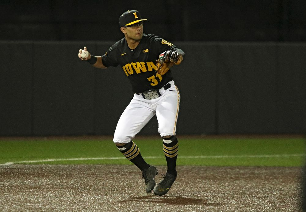 Iowa infielder Matthew Sosa (31) throws to second base to start a double play during the eighth inning of their game at Duane Banks Field in Iowa City on Tuesday, March 3, 2020. (Stephen Mally/hawkeyesports.com)