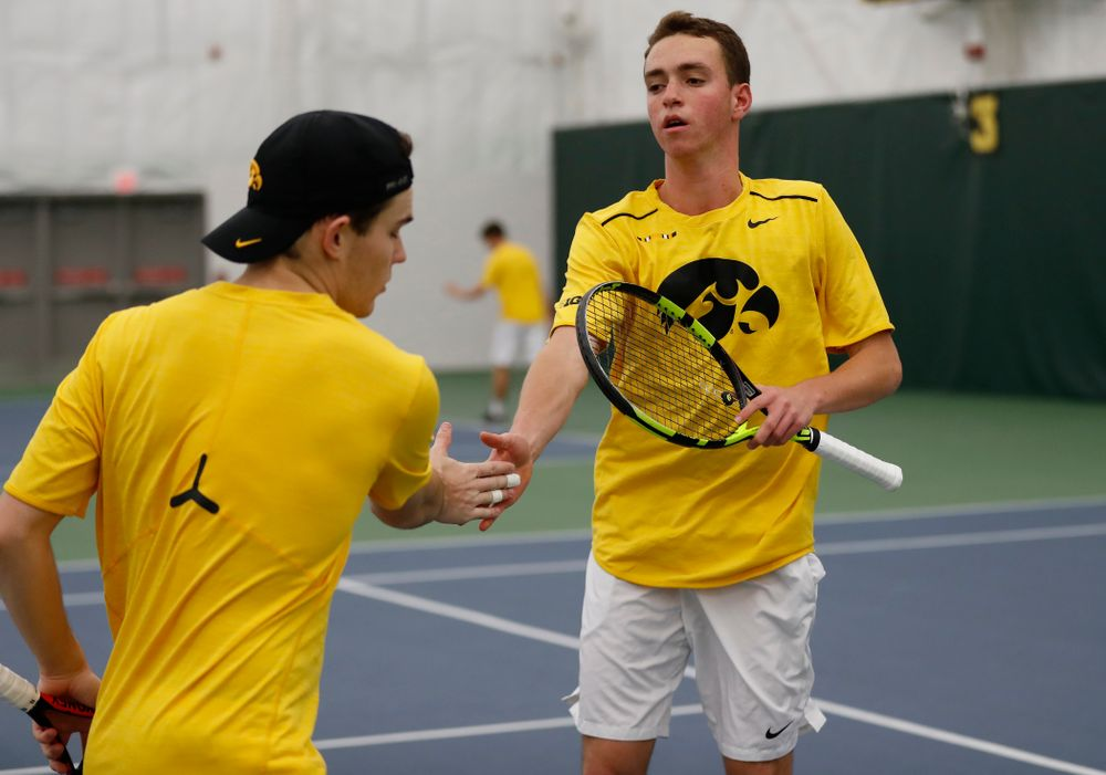 Iowa's Kareem Allaf and Jonas Larsen play a doubles match against Creighton