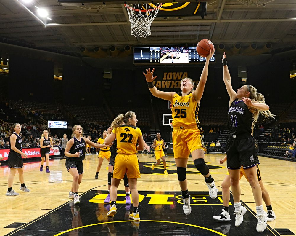 Iowa forward/center Monika Czinano (25) puts up a shot during the second quarter of their game against Winona State at Carver-Hawkeye Arena in Iowa City on Sunday, Nov 3, 2019. (Stephen Mally/hawkeyesports.com)