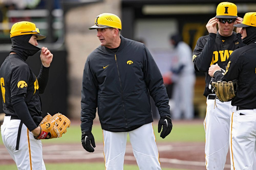 Iowa Hawkeyes head coach Rick Heller talks with his team during the third inning of their game against Illinois at Duane Banks Field in Iowa City on Saturday, Mar. 30, 2019. (Stephen Mally/hawkeyesports.com)