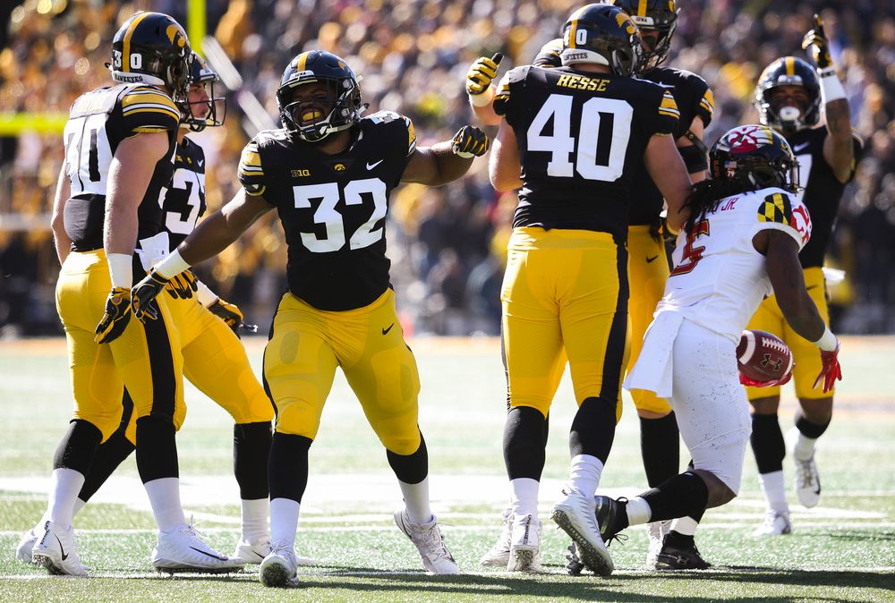 Iowa Hawkeyes linebacker Djimon Colbert (32) reacts after Iowa Hawkeyes defensive end Parker Hesse (40) makes a tackle for loss during a game against Maryland at Kinnick Stadium on October 20, 2018. (Tork Mason/hawkeyesports.com)