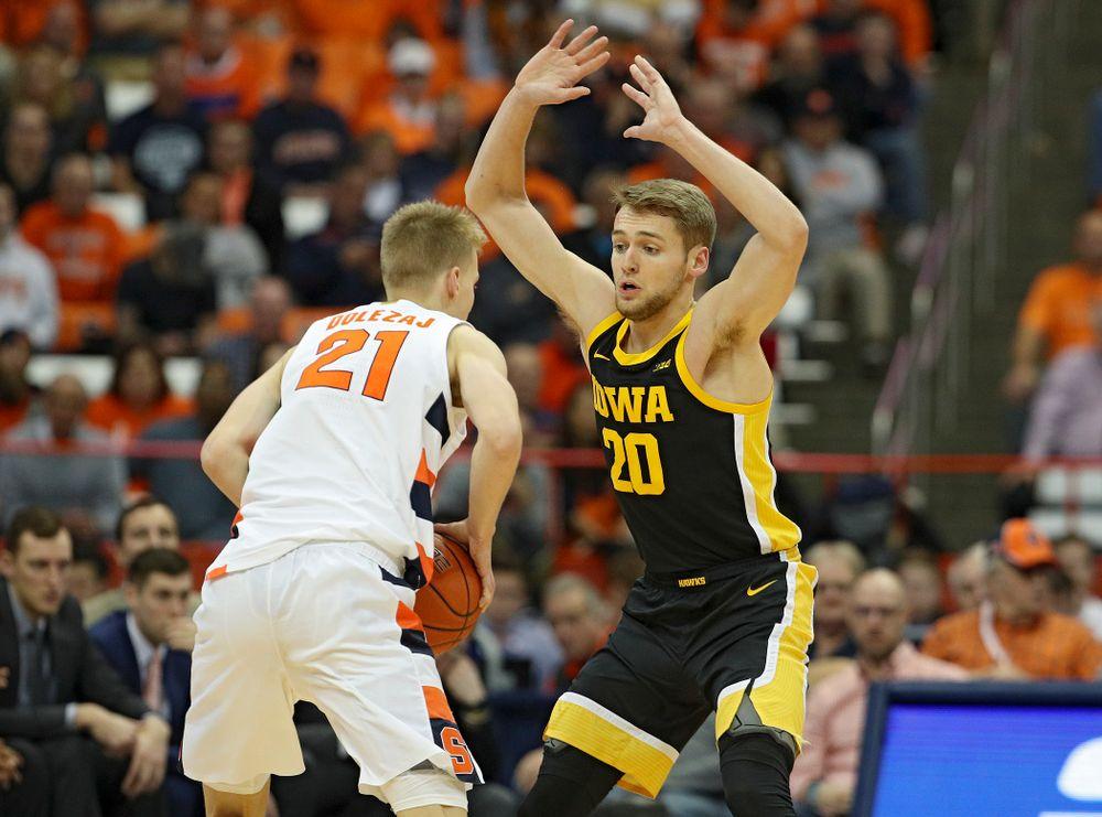 Iowa Hawkeyes forward Riley Till (20) eyes Syracuse Orange forward Marek Dolezaj (21) during the first half of their ACC/Big Ten Challenge game at the Carrier Dome in Syracuse, N.Y. on Tuesday, Dec 3, 2019. (Stephen Mally/hawkeyesports.com)
