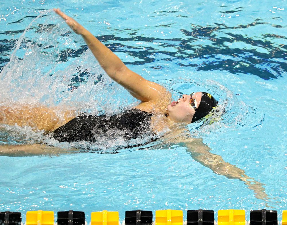 Iowa's Julia Koluch swims the women's 100-yard backstroke event during their meet against Michigan State and Northern Iowa at the Campus Recreation and Wellness Center in Iowa City on Friday, Oct 4, 2019. (Stephen Mally/hawkeyesports.com)