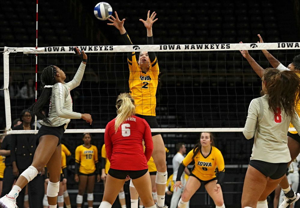 Iowa's Courtney Buzzerio (2) gets her hands on a shot during the first set of their match at Carver-Hawkeye Arena in Iowa City on Friday, Nov 29, 2019. (Stephen Mally/hawkeyesports.com)