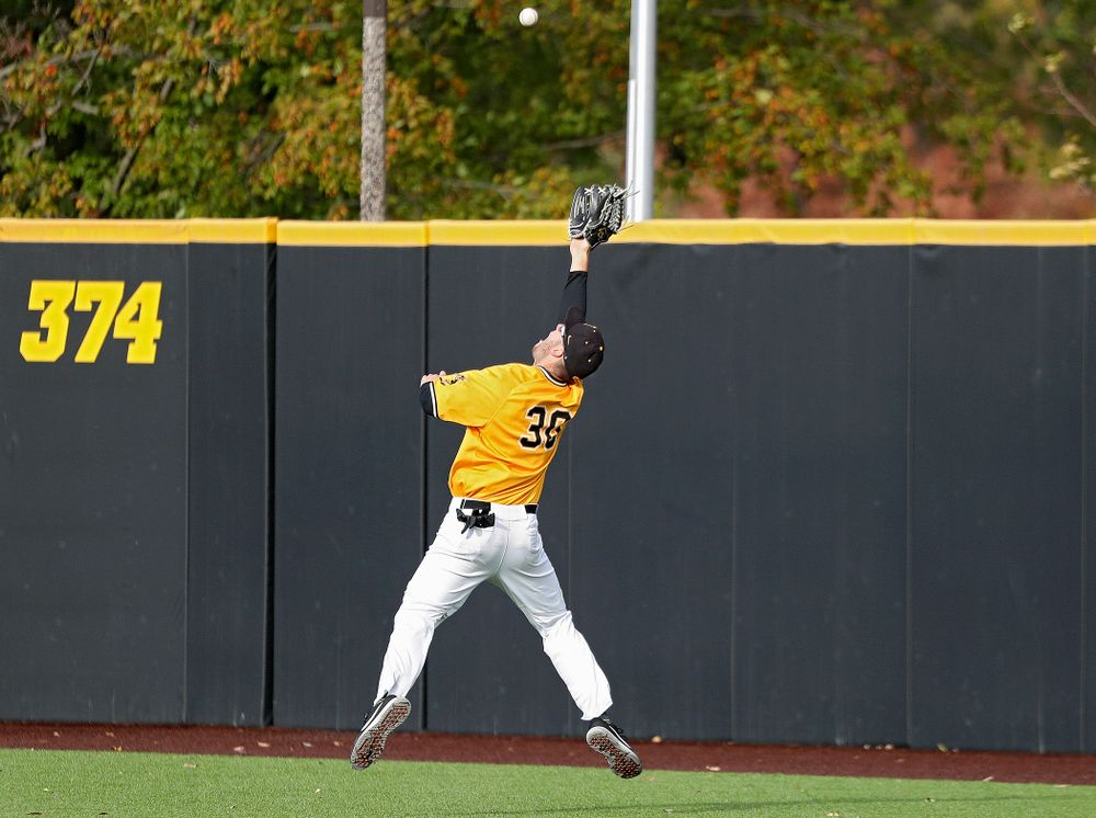 Iowa outfielder Connor McCaffery (30) makes a leaping catch on the run during the third inning of the first game of the Black and Gold Fall World Series at Duane Banks Field in Iowa City on Tuesday, Oct 15, 2019. (Stephen Mally/hawkeyesports.com)