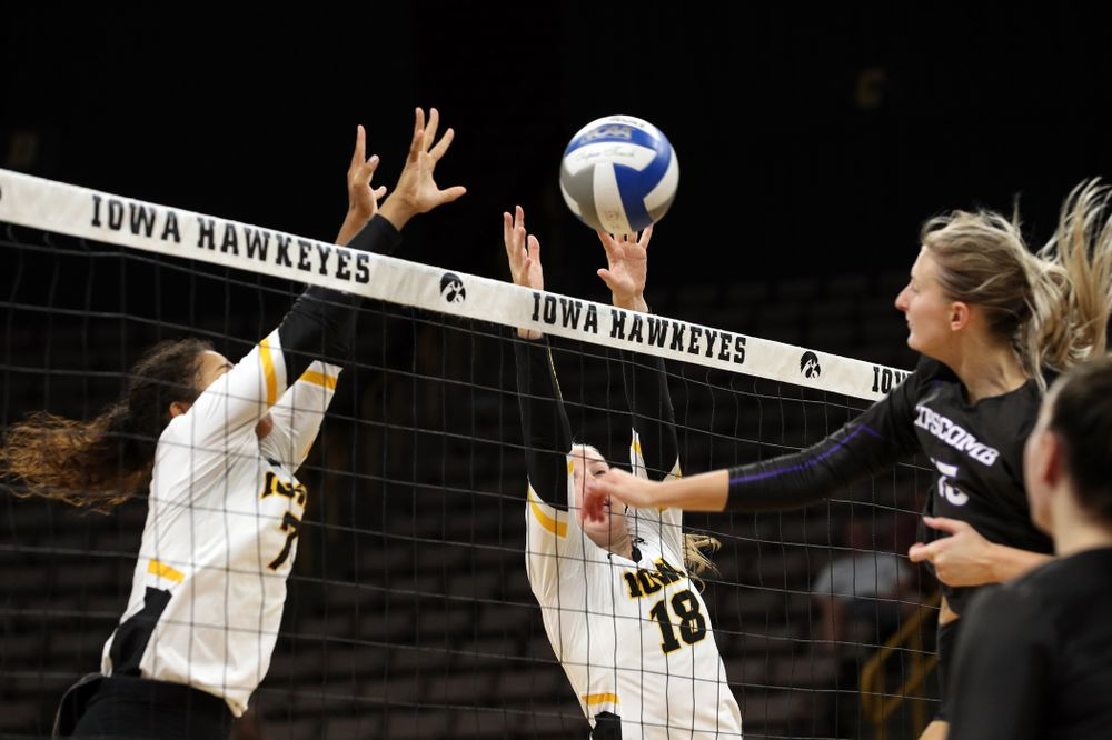 Iowa Hawkeyes middle blocker Hannah Clayton (18) and setter Brie Orr (7) against Lipscomb Friday, September 20, 2019 at Carver-Hawkeye Arena. (Brian Ray/hawkeyesports.com)