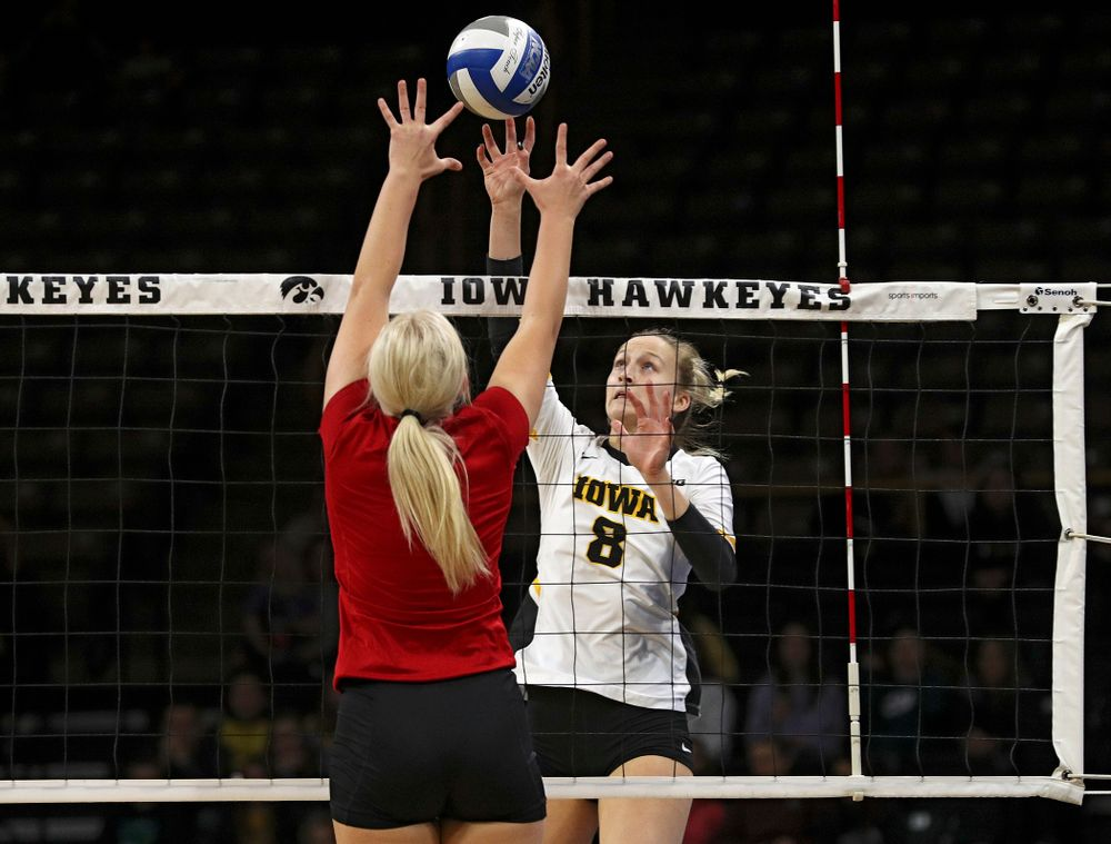Iowa's Kyndra Hansen (8) tips the ball over the net during the first set of their match against Nebraska at Carver-Hawkeye Arena in Iowa City on Saturday, Nov 9, 2019. (Stephen Mally/hawkeyesports.com)