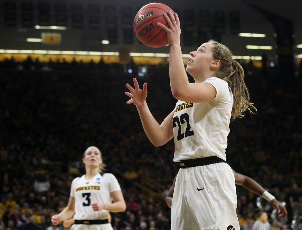 Iowa Hawkeyes guard Kathleen Doyle (22) scores a basket during the third quarter of their second round game in the 2019 NCAA Women's Basketball Tournament at Carver Hawkeye Arena in Iowa City on Sunday, Mar. 24, 2019. (Stephen Mally for hawkeyesports.com)